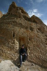 Alex outside a fairy chimney house in Kandovan