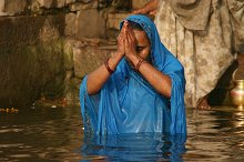 A lady cleansing herself