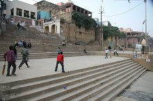 Boys playing cricket on the ghat
