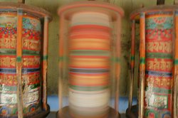 Spinning prayer wheels.