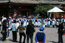 Dancing for and with the tourists at the Old City of Lijiang