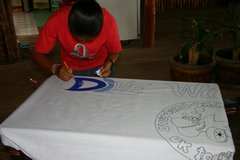 Ita beginning the painting of the banner