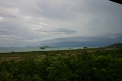 The islands east from mainland Ko Lanta under a menacing sky