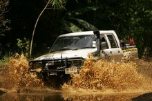 Our 4x4 crashing through the rivers