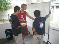 Che, Christophe and onen of the boat boys planning the COT clean up sites