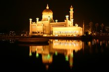Reflections of the mosque lit up at night
