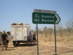 The start of the Gibb River Road and tour bus with puncture