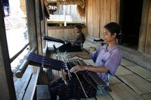 Two of the local women each weaving an ikat