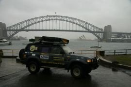 Car in front of Opera House and Harbour Bridge